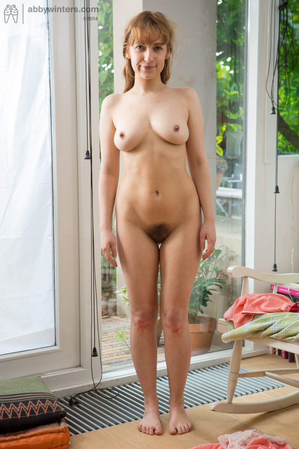 Hairy girl showing off her petite pale body