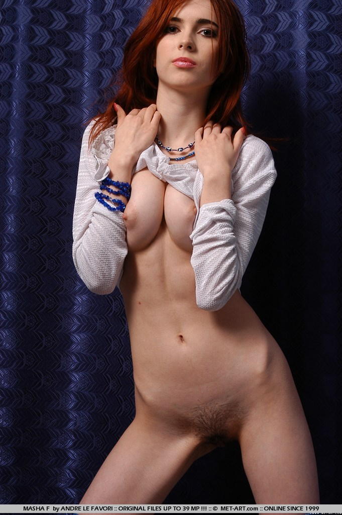 Young red-haired girl showing hairy pussy