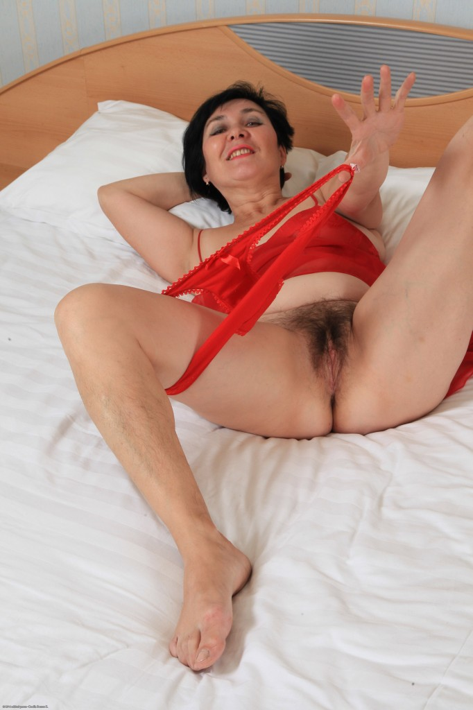 Milf with huge tits masturbates hairy pussy