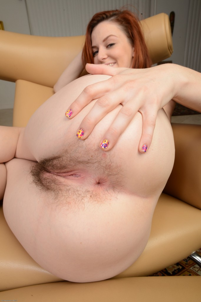 Redhead cute girl Emma Evins spreading hairy cunt