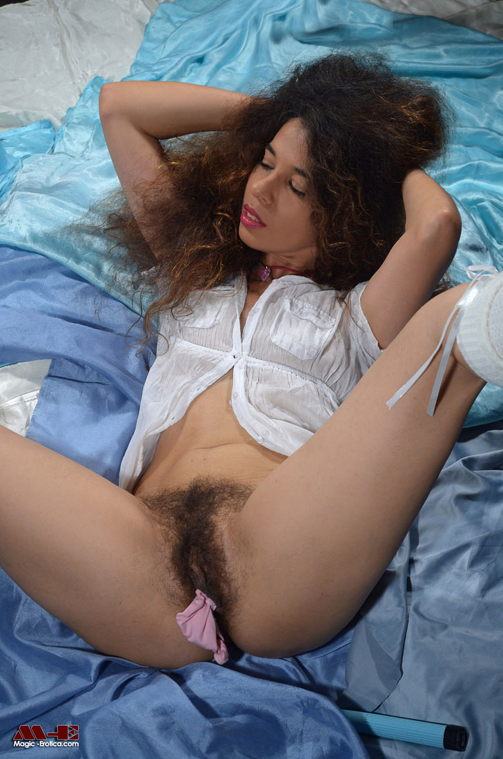 Hairy babe fills her pussy with her panties and toys her ass with a dildo