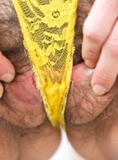 Slender girl exposing her pert breast and hairy vagina