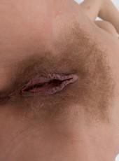 Sensual Ayda opens hairy twat