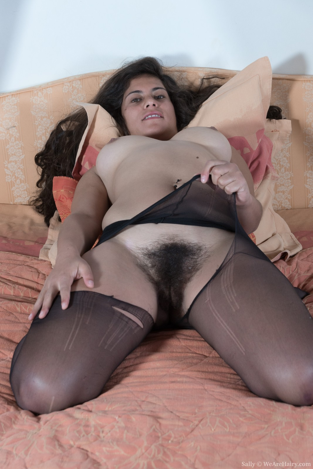 Hairy Sally strips off stockings