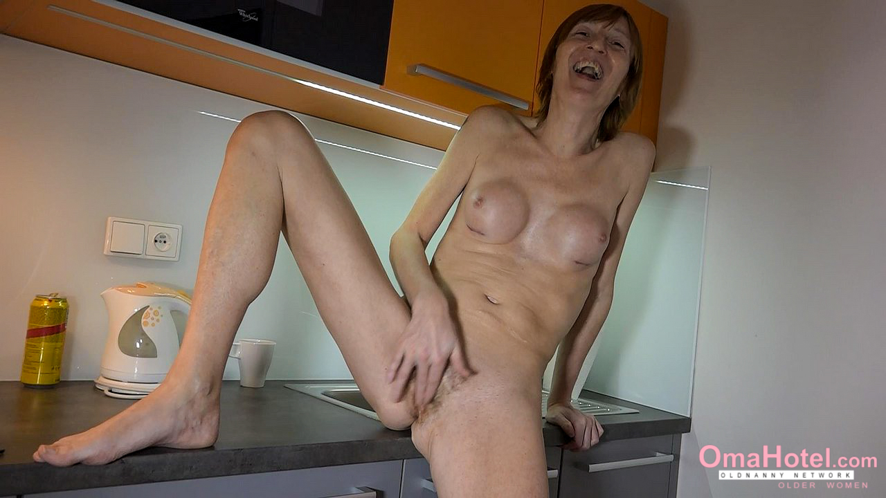Horny grandma is playing with her hairy pussy