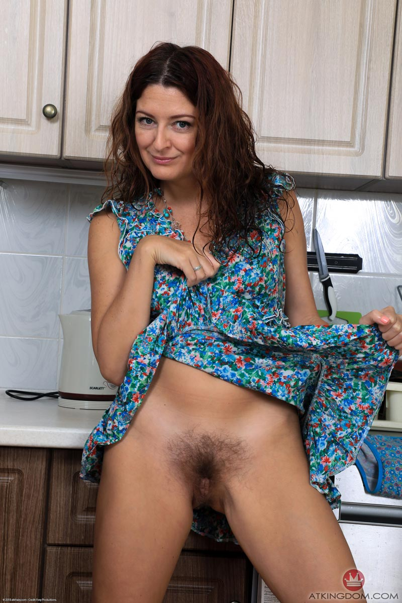 Russian marure Helen Volga shows hairy Pussy in the Kitchen