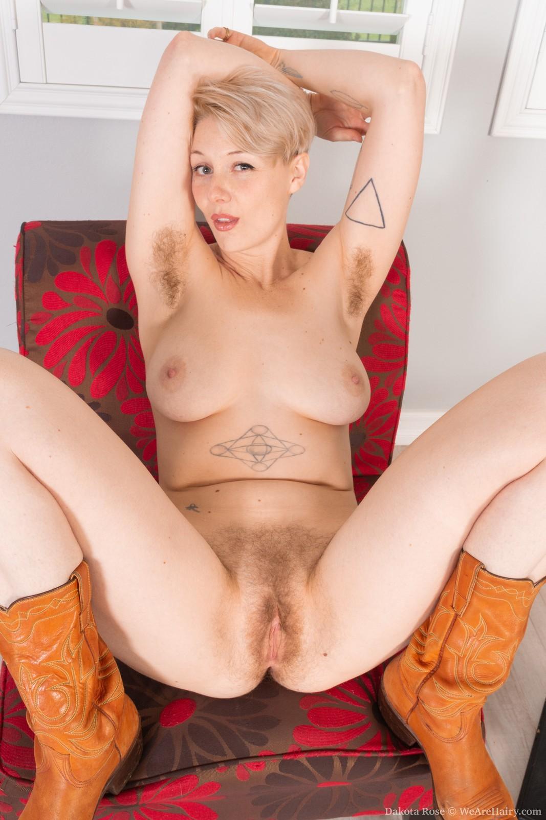 Dakota Rose strips naked wearing cowboy boots