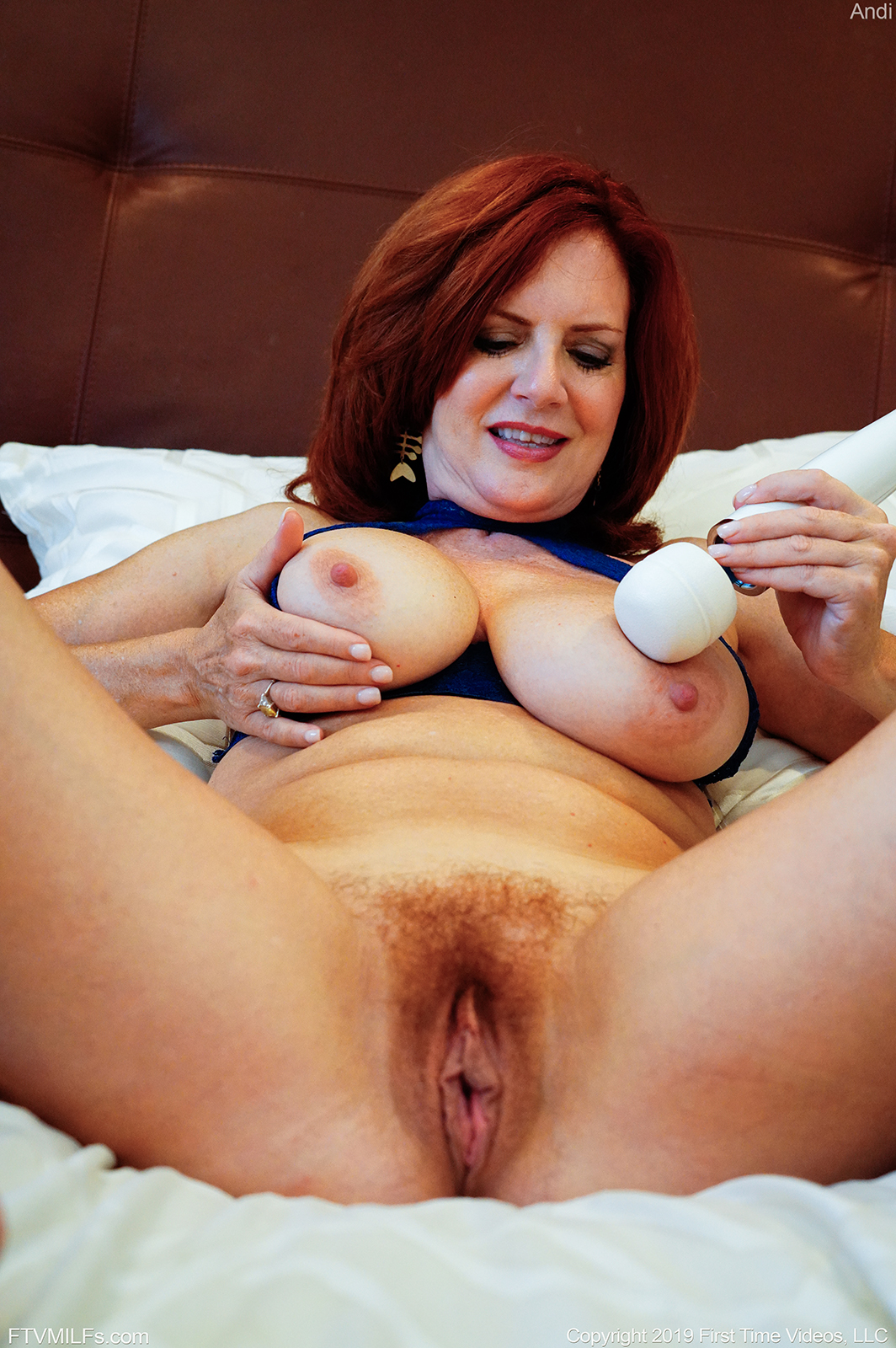 Redhead and busty Andi James