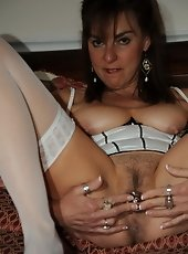 Busty mature in stockings and sexy lingerie