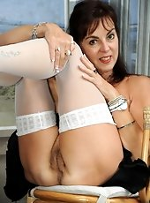 Hairy pussy mature in white stockings