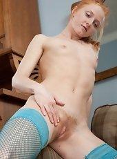 Katie pulls of her horny long socks